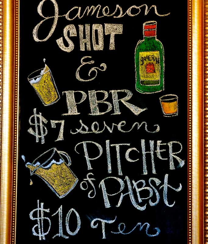 chalkboard of beer specials featured at the Double Urban Tavern
